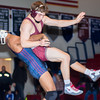Shikellamy's Dominic Parker lifts State College's Ian Barr into air during their 160 lb match on Tuesday evening.