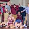State College coaches and wrestlers react after Shikellamy's Noah Supsic takes down State College's Zach Price to take the lead during Tuesday night's match in Sunbury.