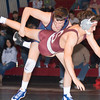 Shikellamy's Noah Supsic takes down State College's Zach Price during their 145 lb match on Tuesday evening at the Shikellamy High School.
