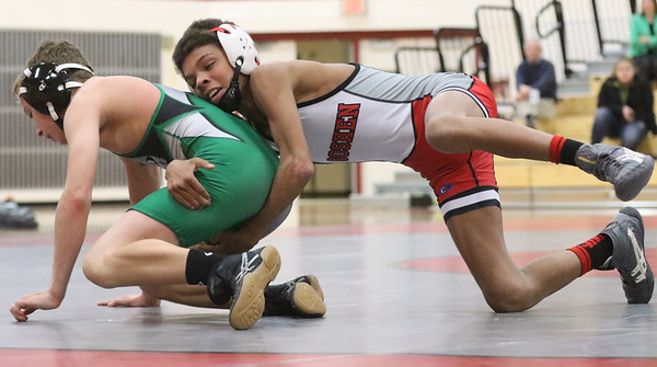JAY YOUNG | THE GOSHEN NEWS<br /> Goshen freshman Rasheek Bonds, right, spends behind Concord freshman Logan Lawson as the two battle in the 113 pound class during their wrestling meet Thursday evening at GHS.