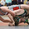 JAY YOUNG | THE GOSHEN NEWS<br /> Goshen junior Noah Cauette, top, presses down on the head of Concord junior Bailey Stockman as the two compete in the 138 pound class during their wrestling meet Thursday evening at GHS.