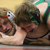 JAY YOUNG | THE GOSHEN NEWS<br /> Goshen junior Noah Cauette, left, struggles to break free from Concord junior Bailey Stockman as the two compete in the 138 pound class during their wrestling meet Thursday evening at GHS.