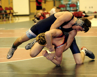The Mills.   Joe Mayes pushes his opponent over for a quick pin.