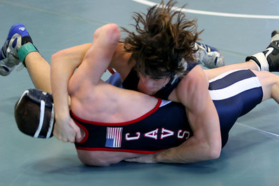 Hair.   Joe Mayes rolls Woodson in the 2005 Liberty District Championships.