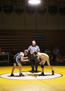 Wrestling at the main event under the spotlight at Langley High School.