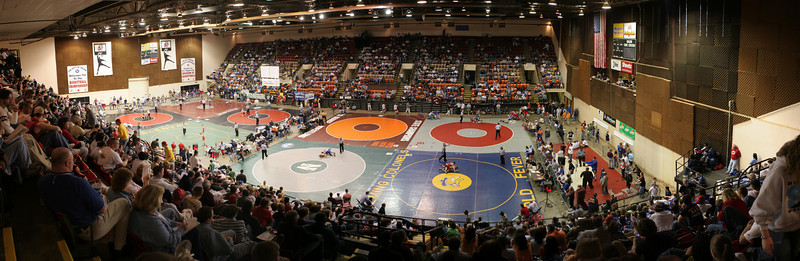 The AA and A State Championship tournament held at the Salem Civic Center in Salem, Virginia.  In the early rounds, there are eight mats with simultaneous wrestling, four on the left for the Single-A Division, and four on the right for AA.