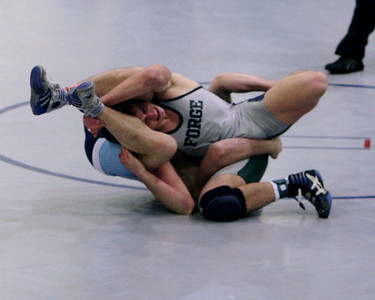 Both looking for an opening, rolling through a hold.  This is Kyle Jones versus Colonial Forge at the quarterfinals of the 2005 Virginia State Championship.