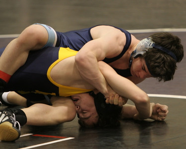 Kevin Eberling punishes another wrestler with the scissors.
