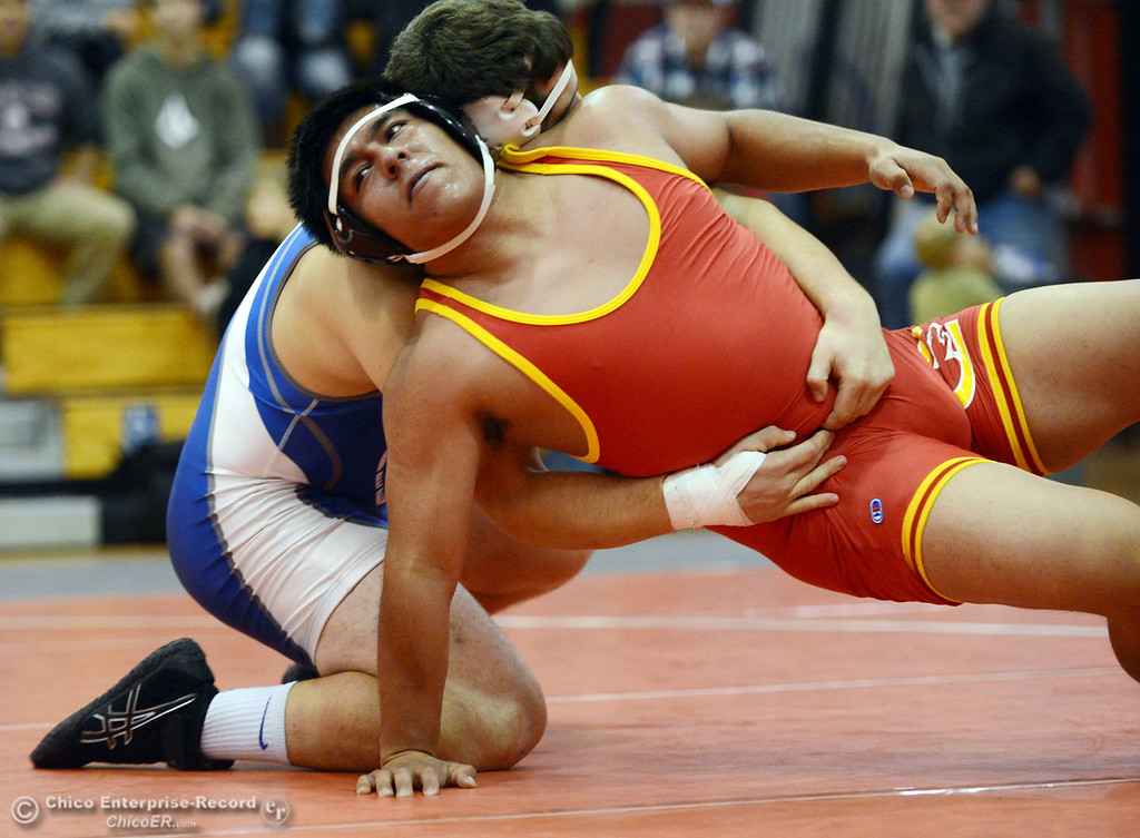 . Chico High\'s Alex Coria (right) wrestles against Orland High\'s Vic Rayhoza (left) in the 220 lbs wrestling match at CHS Wednesday, December 18, 2013 in Chico, Calif. (Jason Halley/Chico Enterprise-Record)