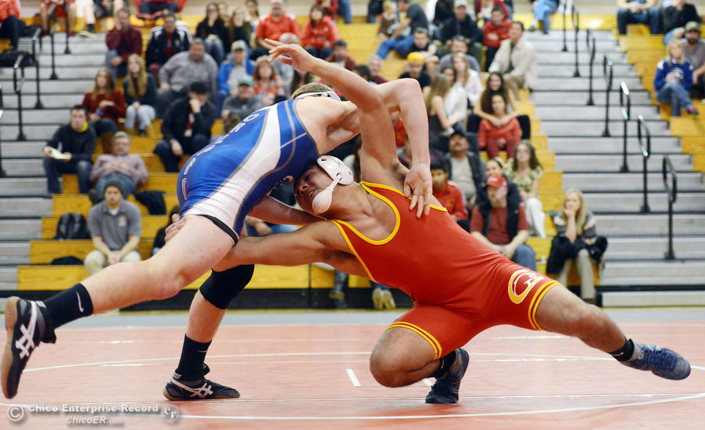 . Chico High\'s John Leal (right) wrestles against Orland High\'s Lane Williams (left) in the 170 lbs wrestling match at CHS Wednesday, December 18, 2013 in Chico, Calif. (Jason Halley/Chico Enterprise-Record)