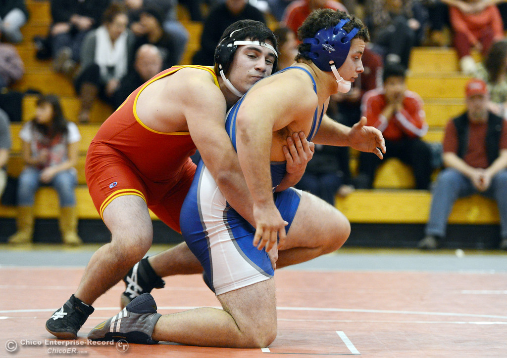 . Chico High\'s Santino Giambalvo (left) wrestles against Orland High\'s Domenic Alves (right) in the 195 lbs wrestling match at CHS Wednesday, December 18, 2013 in Chico, Calif. (Jason Halley/Chico Enterprise-Record)