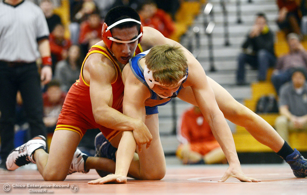 . Chico High\'s David Leyva (left) wrestles against Orland High\'s Quinton Hill (right) in the 145 lbs wrestling match at CHS Wednesday, December 18, 2013 in Chico, Calif. (Jason Halley/Chico Enterprise-Record)