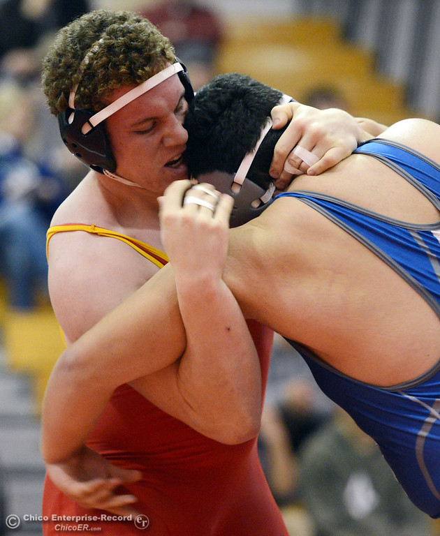 . Chico High\'s Malik Hopkins (left) wrestles against Orland High\'s Carlos Gomez (right) in the 285 lbs wrestling match at CHS Wednesday, December 18, 2013 in Chico, Calif. (Jason Halley/Chico Enterprise-Record)
