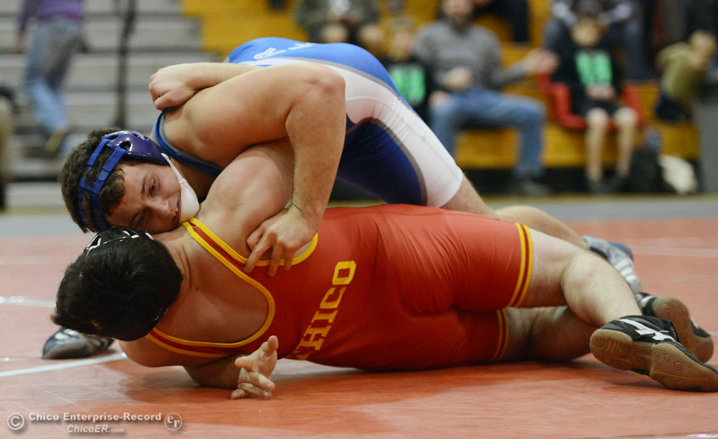 . Chico High\'s Santino Giambalvo (bottom) wrestles against Orland High\'s Domenic Alves (top) in the 195 lbs wrestling match at CHS Wednesday, December 18, 2013 in Chico, Calif. (Jason Halley/Chico Enterprise-Record)