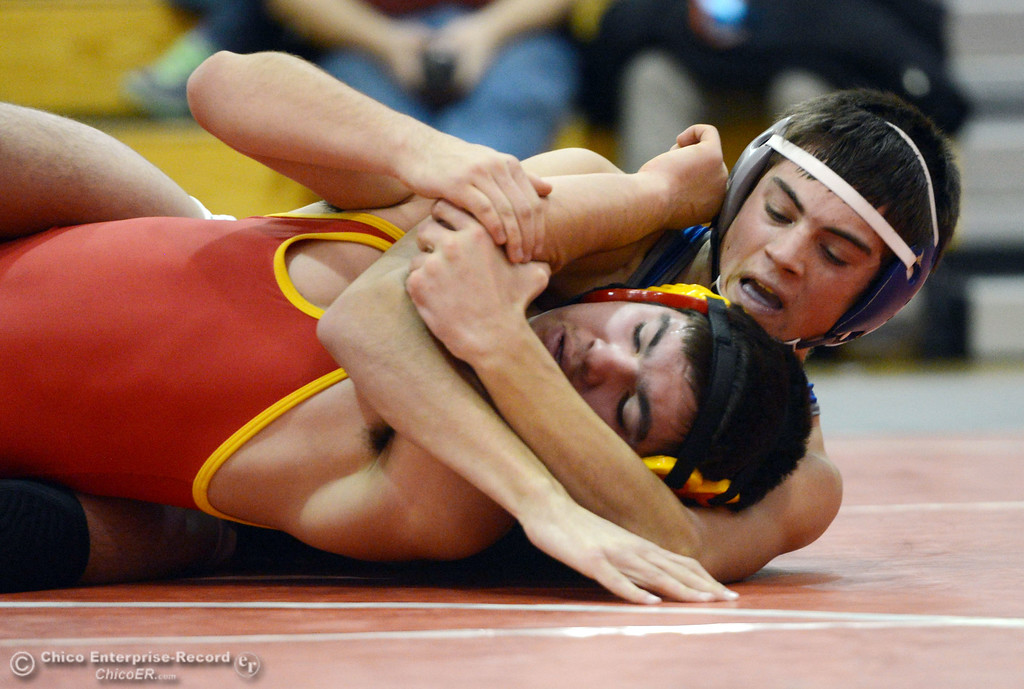 . Chico High\'s Emiliano Chavez (front) wrestles against Orland High\'s Steven Abbott (back) in the 152 lbs wrestling match at CHS Wednesday, December 18, 2013 in Chico, Calif. (Jason Halley/Chico Enterprise-Record)