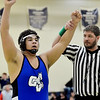 WARREN  DILLAWAY | Star Beacon<br /> Grand Valley 285 pounder Austin Mathis raises is arms in victory after defeating Northwestern's Jonah Ours during a Division III regional championship bout on Saturday at Garfield Heights.