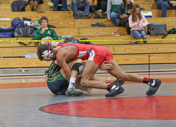 Goshen's Rasheek Bonds works at flipping his opponent on his back to secure a pin in the final round of the Goshen Invitational Saturday morning.