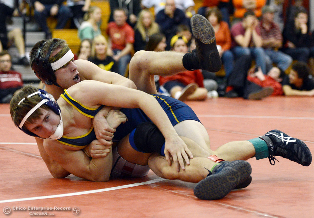. Las Plumas High\'s Lake Gee (back) wrestles against Henley High\'s Cooper Noonan (front) in their 138 lbs match at the Joe Rios Memorial Wrestling Tournament at CHS Saturday, January 4, 2014 in Chico, Calif.  (Jason Halley/Chico Enterprise-Record)