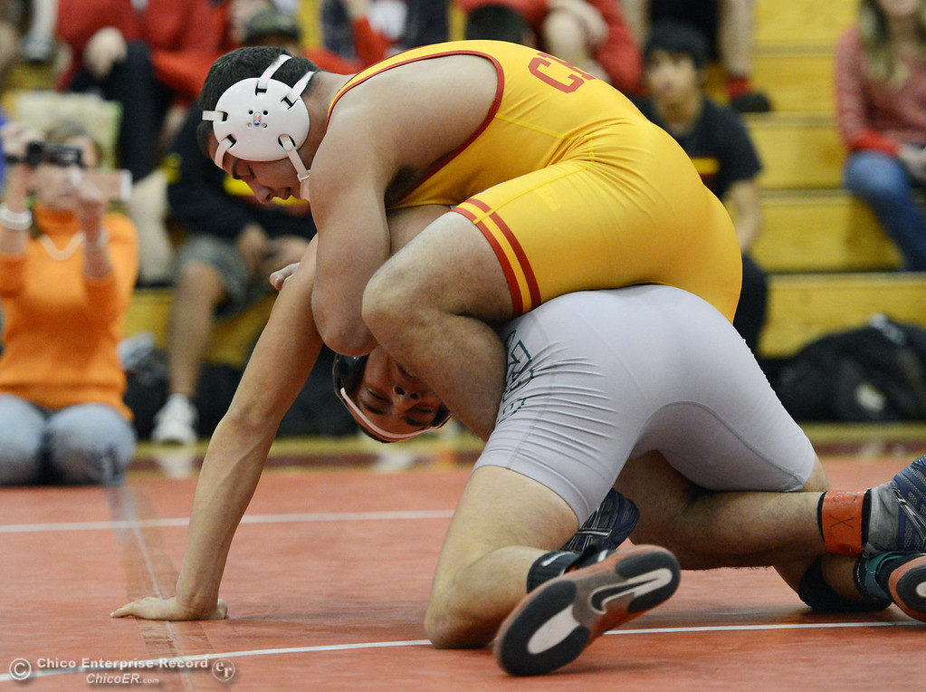 . Chico High\'s John Leal (top) wrestles against Ponderosa High\'s Trea Providence (bottom) in their 170 lbs match at the Joe Rios Memorial Wrestling Tournament at CHS Saturday, January 4, 2014 in Chico, Calif.  (Jason Halley/Chico Enterprise-Record)