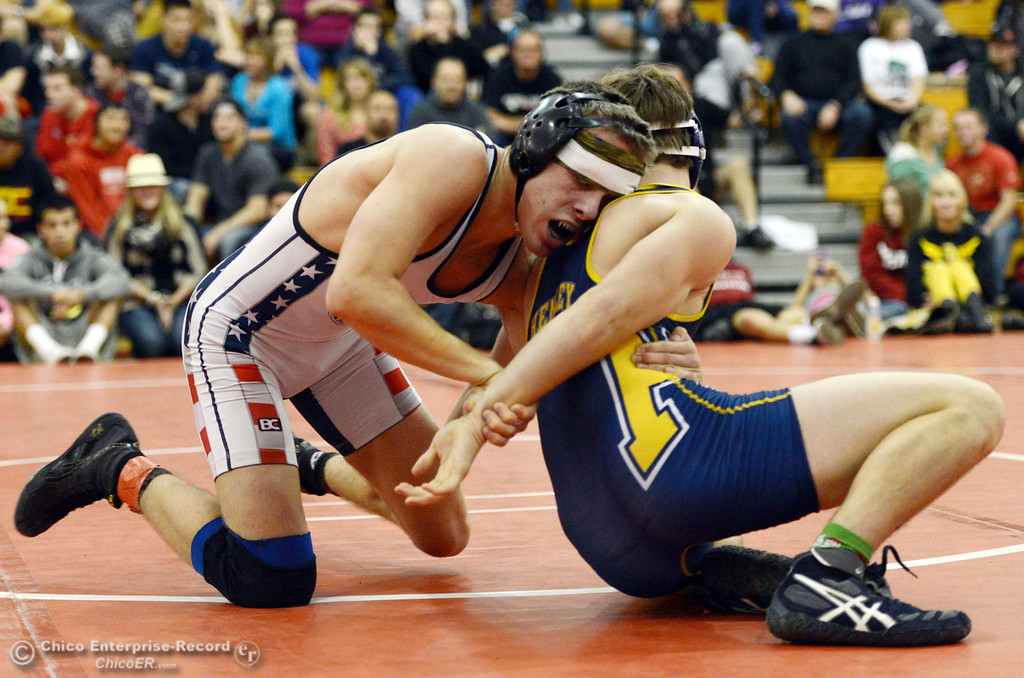 . Las Plumas High\'s Lake Gee (left) wrestles against Henley High\'s Cooper Noonan (right) in their 138lbs match at the Joe Rios Memorial Wrestling Tournament at CHS Saturday, January 4, 2014 in Chico, Calif.  (Jason Halley/Chico Enterprise-Record)