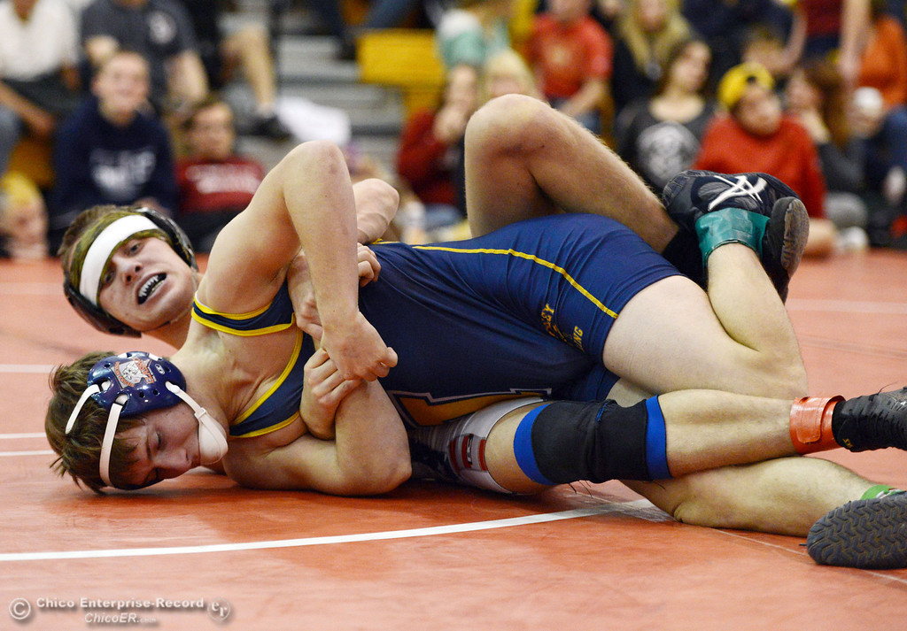 . Las Plumas High\'s Lake Gee (back) wrestles against Henley High\'s Cooper Noonan (front) in their 138lbs match at the Joe Rios Memorial Wrestling Tournament at CHS Saturday, January 4, 2014 in Chico, Calif.  (Jason Halley/Chico Enterprise-Record)