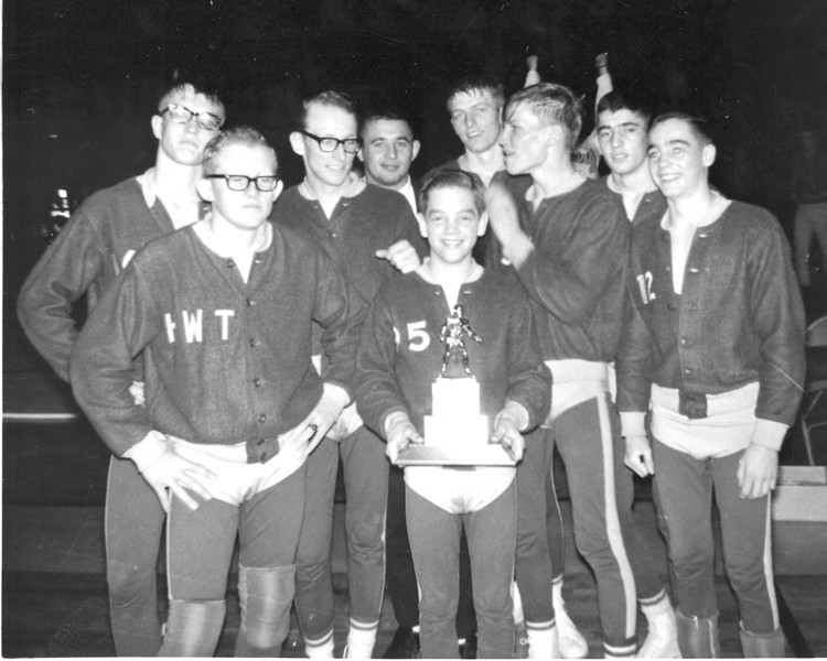 1966 KS State Wrestling Champions<br /> front left: Stan Keller Sr.HWT 4th; Mike Holliman So 95# 4th; Stan Faulkender So. 112# 1st<br /> second row lft: Steve Cook Jr. 165# 2nd; Rick Rogers Sr. 138# 3rd; Mike Cook Sr.145# 2nd; Roger Faulkender Sr. 133# 3rd; Back Row: Coach Gary Wilson; Tom Keller Sr. 180# 1st