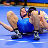 Leominster's P.J. Kendall (left) tries to stay off the mat while wrestling Monty Tech's Dennis Begley, Wednesday night.<br /> SENTINEL & ENTERPRISE / BRETT CRAWFORD