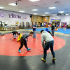 The Monty Tech wrestling team practices in the Fitchburg school's cafeteria on Monday.<br /> SENTINEL & ENTERPRISE / BRETT CRAWFORD