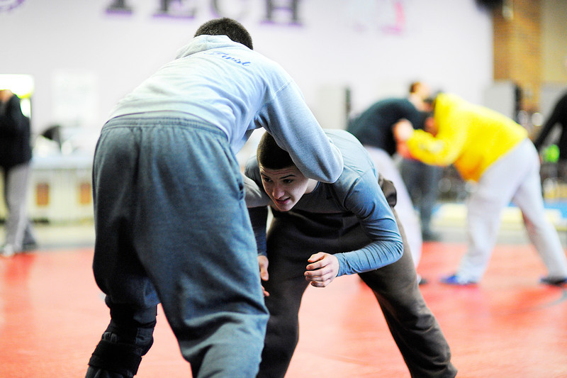 Monty Tech freshman Tyler Popp (right) wrestles against teammate Dennis Begley, a junior, during practice on Monday.<br /> SENTINEL & ENTERPRISE / BRETT CRAWFORD