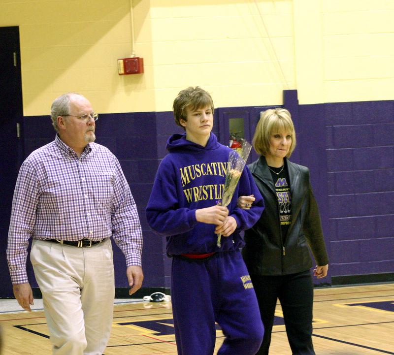 Joe Taylor and his parents on Senior Night
