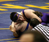 Mike Tobias trying to pin his opponent