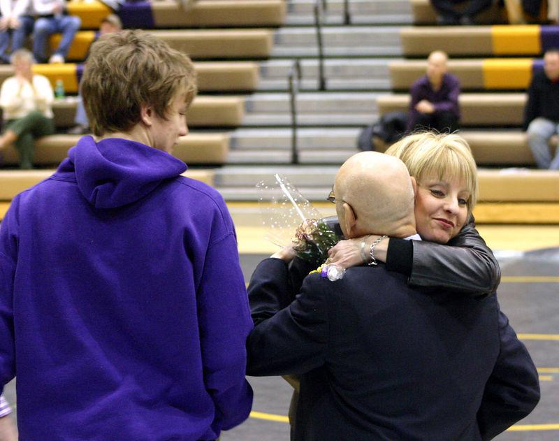 Joe Taylor with mom Judy giving the coach a big hug.