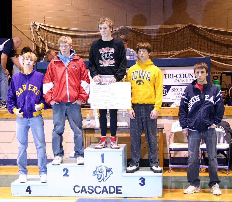 Colin receiving third place at Cascade tournament.