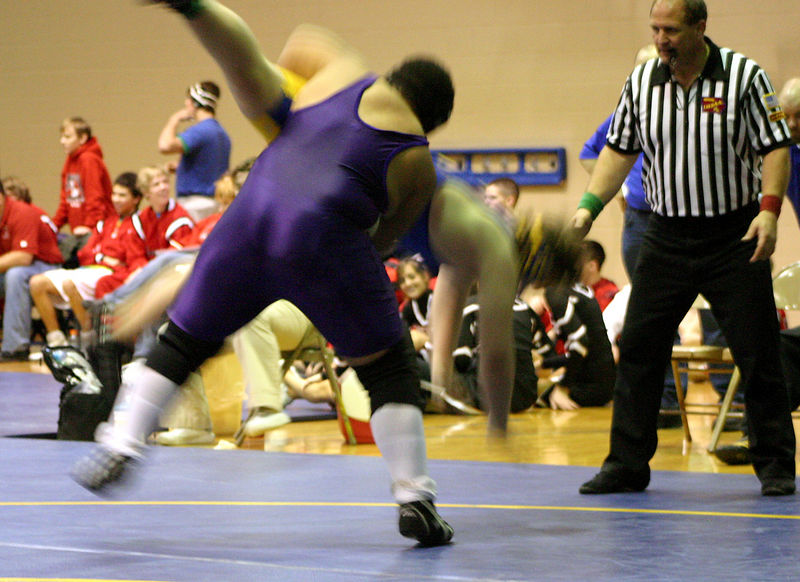 Hiram throwing his Davenport North opponent to the mat.