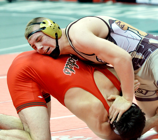 WARREN DILLAWAY / Star Beacon<br /> Pymatuning Valley 182 pounder Gaige Willis (top) wrestles Oak Harbor's  Kian Thompson on Friday morning during a Division II quarterfinal match at the Division III Ohio High School State Wrestling Tournament at the Schottenstein Center in Columbus.