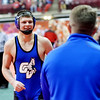 WARREN DILLAWAY / Star Beacon<br /> Grand Valley's Cody Rhoades reacts with joy while walking toward head coach Keith Sherman on Friday after he won a 138 pound consolation match at the Ohio High School Athletic Association Wrestling Tournament at the Schottenstein Center in Columbus.