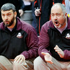 WARREN DILLAWAY / Star Beacon<br /> Pymatuning Valley head wrestling coach David Miller left) and his assistant David Benedict applaud 182 pounder Gaige Wilis during a quarterfinal match during the Ohio High School State Wrestling tournament at the Schottenstein Center in Columbus.