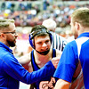WARREN DILLAWAY / Star Beacon<br /> Grand Valley's Cody Rhoades (center) celebrates with head wrestling coach Keith Sherman (left) on Friday during the state wrestling tournament in Columbus.