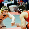 WARREN DILLAWAY / Star Beacon<br /> Pymatuning Valley's Gaige Willise (left) wrestles Oak Harbor's Kian Thompson on Friday morning during a 182 pound quarterfinal match at the Division III Ohio High School Athletic Association Association State Wrestling Tournament at the Schottenstein Center in Columbus.