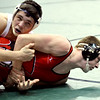 WARREN DILLAWAY / Star Beacon<br /> Perry's John Miller (right) tries to escape during a Division II 170 pound consolation match on Friday at the Ohio High School State Wrestling match in Columbus.