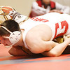 WARREN  DILLAWAY | Star Beacon <br /> Pymatuning Valley's Chase Vickery tries to keep his back off the mat as Geneva's John Amato goes for the pin during a 180 pound bout on Thursday evening in Geneva.