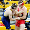 WARREN  DILLAWAY | Star Beacon<br /> Geneva's Cody Brown (right)  wrestles Tommy Gill of St. Ignatius on Saturday at the Riverside Rumble in Painesville Township.
