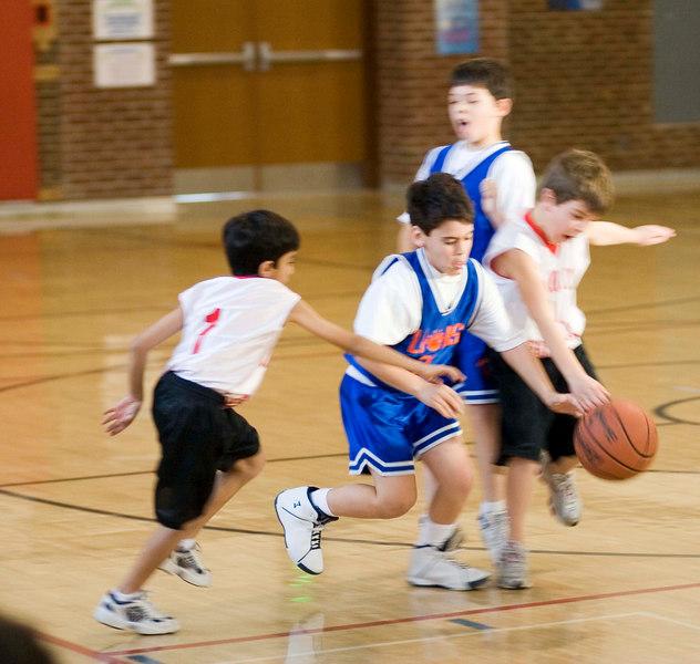 Daniel taking on two defenders.