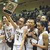 Troy Lady Flying Horses Mary Pattison holds up the Section II plaque with other teem mates after winning the Class A championship game at Hudson Valley Community Collage (Jeff Couch / The Record)