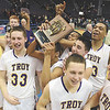 Troy players hold section 2 plaque after defeaing Green Tech 70-55 in high school boys Class 'AA' basketball championship action Monday, March 4, 2013 at the Times Union Center. (J.S. Carras / The Record)