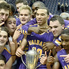 Mike McMahon - The Record, 2nd half  of UAlbany players celebrate with Albany Cup for win vs Siena 74-62, men's basketball for the Albany Cup at the Times Union Center in Albanyl, Friday November 1. 2013.