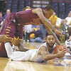 Siena's Rakeem Brookins battles for the ball on the floor against Iona's Lamont Jones (2) during first half of men's college basketball action Friday,  January 4, 2013 at Times Union Center in Albany. (J.S.Carras/The Record)