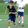 Dillon Roman, runs against a resistance band as partner Isaac Forbush creates the resistance for the drill during a youth endurance camp at Broomfield County Commons Park on Monday July 9, 2012.<br /> Photo by Paul Aiken