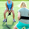 Tori Kilgour, left works on a leg squat drill with partner Reilly Bayliss during a youth endurance camp at Broomfield County Commons Park on Monday July 9, 2012.<br /> Photo by Paul Aiken