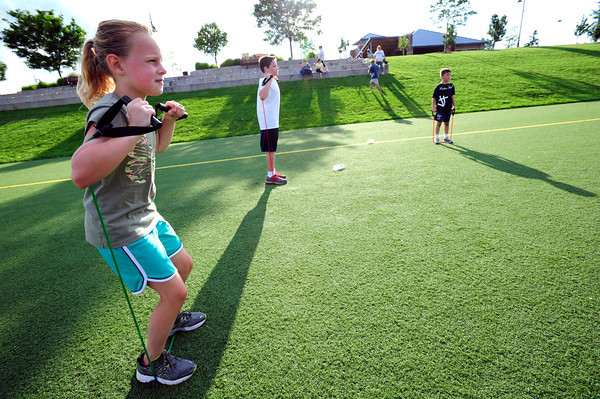 Reilly Bayliss works with a resistance band during a youth endurance camp at Broomfield County Commons Park on Monday July 9, 2012.<br /> Photo by Paul Aiken
